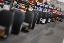 GP2 cars wait to exit the pit-lane