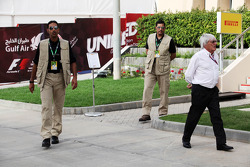 Bernie Ecclestone, CEO Formula One Group, with security following