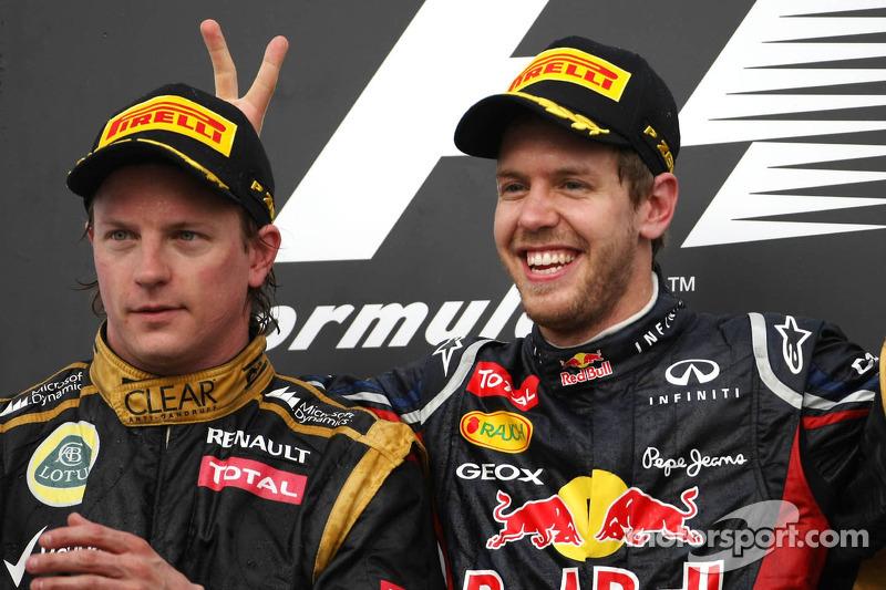 Kimi Raikkonen, Lotus F1 Team and Sebastian Vettel, Red Bull Racing