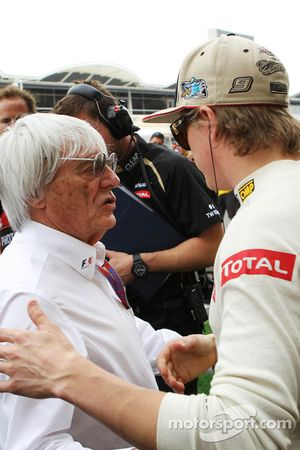 Bernie Ecclestone, CEO Formula One Group, with Kimi Raikkonen, Lotus F1 Team on the grid