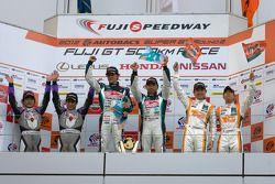 GT300 podium: winners Tatsuya Kataoka and Nobuteru Taniguchi, second place Kazuho Takahashi and Hiro