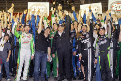 Race winner Jimmie Johnson and the rest of the Hendricks Motorsport crew celebrate 200 wins