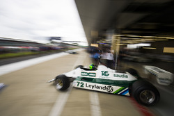 A Carlos Reutemann Williams FW07B leaves a pit garage