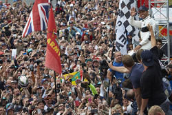 Race winner Lewis Hamilton, Mercedes AMG F1, celebrates with the fans after winning the race