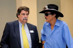 Mike Helton, President of NASCAR, speaks with Hall of Famer Richard Petty