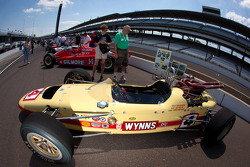 Vintage cars on display on pitlane
