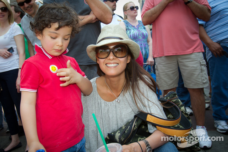 Indy 500 festival parade: Kumiko Goto, wife of Jean Alesi with her son