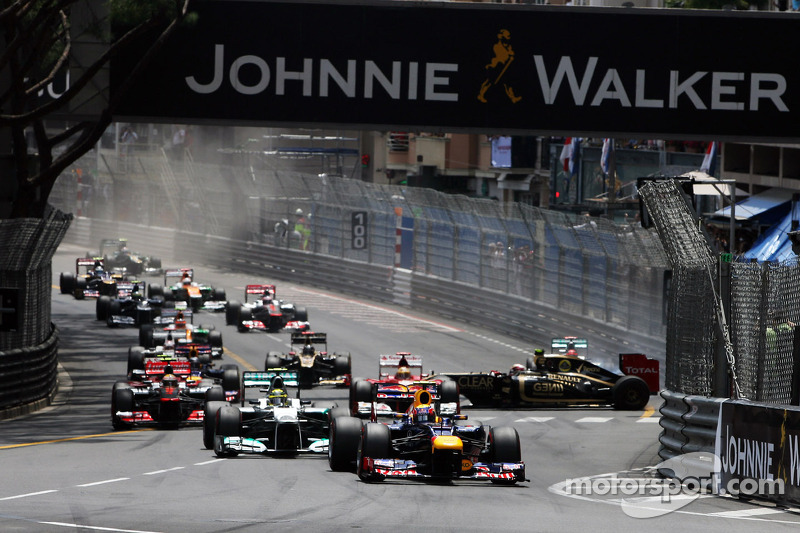 Mark Webber, Red Bull Racing leads at the start of the race as Michael Schumacher, Mercedes AMG F1 a
