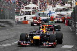 Race winner Mark Webber, Red Bull Racing leads second placed Nico Rosberg, Mercedes AMG F1 and third