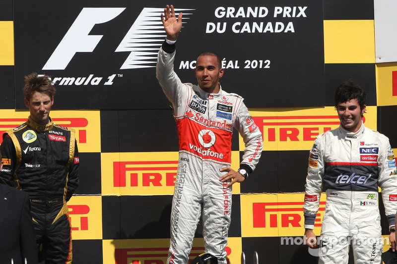 Podio: segundo lugar Romain Grosjean, de Lotus F1 Team, ganador de la carrera Lewis Hamilton, McLaren Mercedes Mercedes y tercer lugar Sergio Pérez, Sauber F1 Team