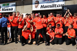 Race winner Lewis Hamilton, McLaren Mercedes celebrates with the team