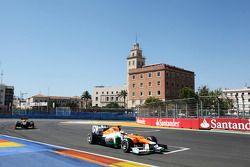 Paul di Resta, Sahara Force India leads Kimi Raikkonen, Lotus F1