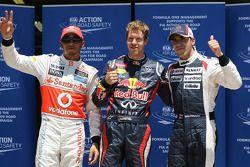 Polepositie Sebastian Vettel, Red Bull Racing met Lewis Hamilton, McLaren Mercedes in 2de plaats en