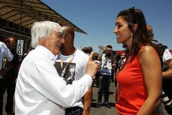 Roberto Carlos, Football Player with Bernie Ecclestone, CEO Formula One Group, and Fabiana Flosi