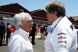 Bernie Ecclestone, CEO Formula One Group, with Norbert Haug, Mercedes Sporting Director on the grid