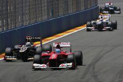 Fernando Alonso, Scuderia Ferrari and Kimi Raikkonen, Lotus F1 Team