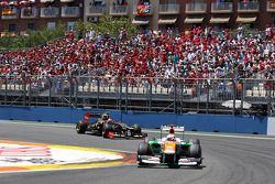 Paul di Resta, Sahara Force India leads Romain Grosjean, Lotus F1