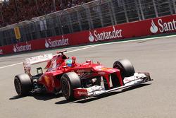 Race winner Fernando Alonso, Ferrari celebrates at the end of the race