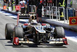 Second placed Kimi Raikkonen, Lotus F1 enters parc ferme