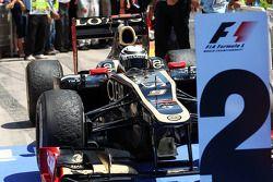 Second placed Kimi Raikkonen, Lotus F1 in parc ferme