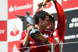 Race winner Fernando Alonso, Ferrari celebrates on the podium with Andrea Stella, Ferrari Race Engineer