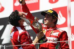 Race winner Fernando Alonso, Ferrari celebrates on the podium with Andrea Stella, Ferrari Race Engin