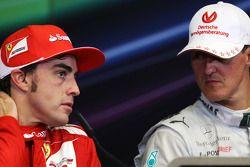 Race winner Fernando Alonso, Ferrari with Michael Schumacher, Mercedes AMG F1 in the FIA Press Conference