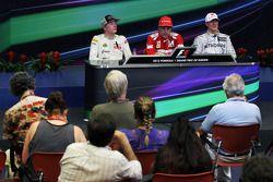 The post race FIA Press Conference Kimi Raikkonen, Lotus F1 Team, second; Fernando Alonso, Ferrari, race winner; Michael Schumacher, Mercedes AMG F1, third