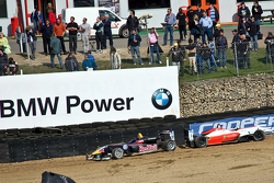 The wrecked cars of Carlos Sainz Jr. and Pipo Derani