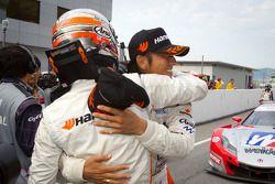 GT300 winners Tomonobu Fujii and Masami Kageyama celebrate