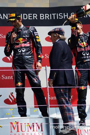 Sebastian Vettel, Red Bull Racing pours champagne on Jackie Stewart, on the podium as race winner Ma