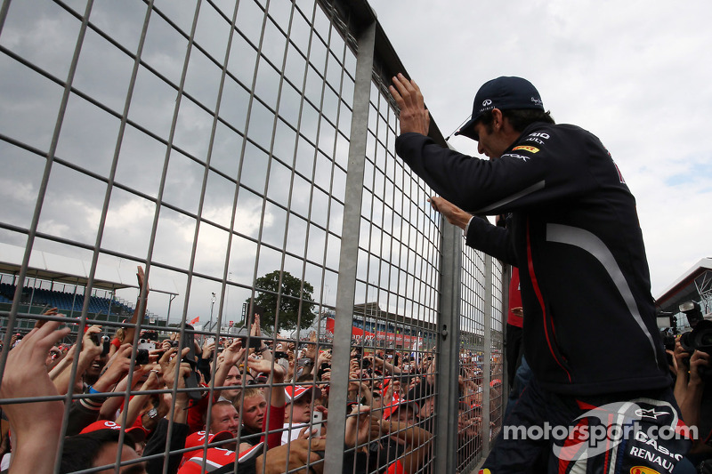 Race winner Mark Webber, Red Bull Racing celebrates after the race