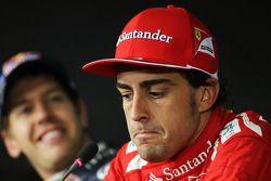 Pole sitter Fernando Alonso, Scuderia Ferrari and Sebastian Vettel, Red Bull Racing in the FIA Press