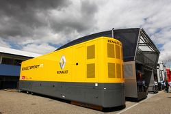 Red Bull Racing Comms Unit and Renault F1 Sport Truck with some dark clouds hanging over it