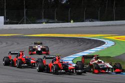 Pedro De La Rosa, HRT Formula 1 Team; Charles Pic, Marussia F1 Team y Timo Glock, Marussia F1 Team a