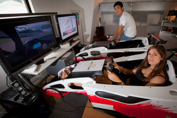 Cyndie Allemann and Hideto Yasuoka in a racing simulator