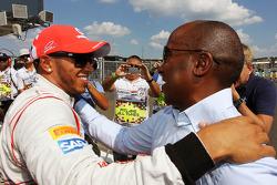 Lewis Hamilton, McLaren celebrates his pole position in parc ferme with father Anthony Hamilton