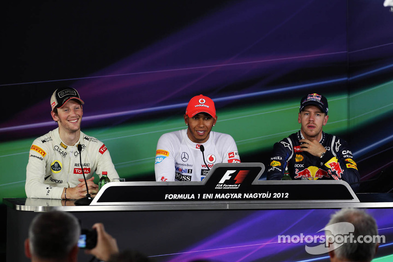 pole para Lewis Hamilton, McLaren Mercedes, segundo Romain Grosjean, Lotus Renault F1 Team y tercero Sebastian Vettel, Red Bull Racing