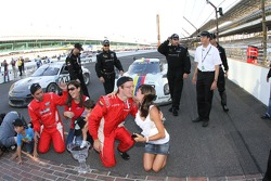 Overall race winners Alex Popow, Sébastien Bourdais kiss the yard of bricks