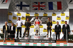 The podium, Kimi Raikkonen, Lotus F1 Team, second; Lewis Hamilton, McLaren, race winner; Romain Gros