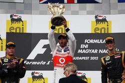 The podium, Kimi Raikkonen, Lotus F1 Team, second; Lewis Hamilton, McLaren, race winner; Romain Grosjean, Lotus F1 Team, third