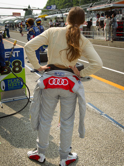 Cyndie Allemann looks on as the #21 Hitotsuyama Racing Audi R8 LMS is stopped at pit entrance