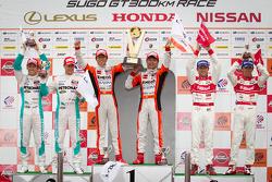 GT500 podium; winners Daisuke Ito and Kazuya Oshima, second place Kazuki Nakajima and Loic Duval, third place Masataka Yanagida and Ronnie Quintarelli
