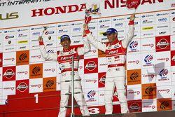 GT500 podium: winners Masataka Yanagida and Ronnie Quintarelli