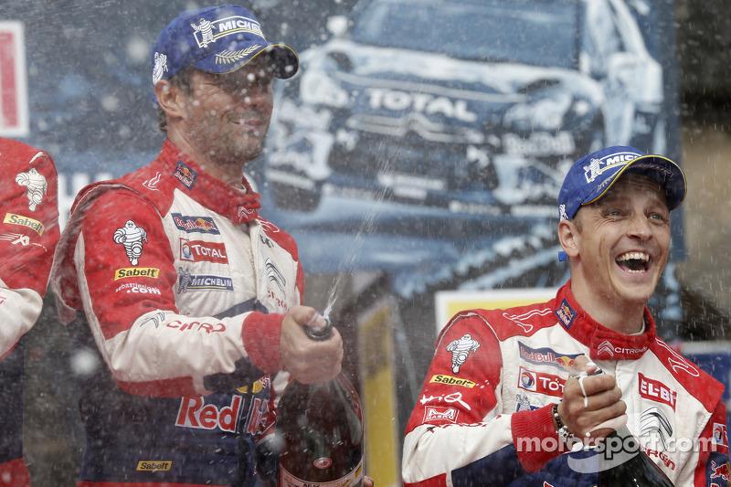 Podium: winner Sébastien Loeb, second place Mikko Hirvonen, Citroën Total World Rally Team