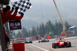 Matias Laine takes the checkered flag to win