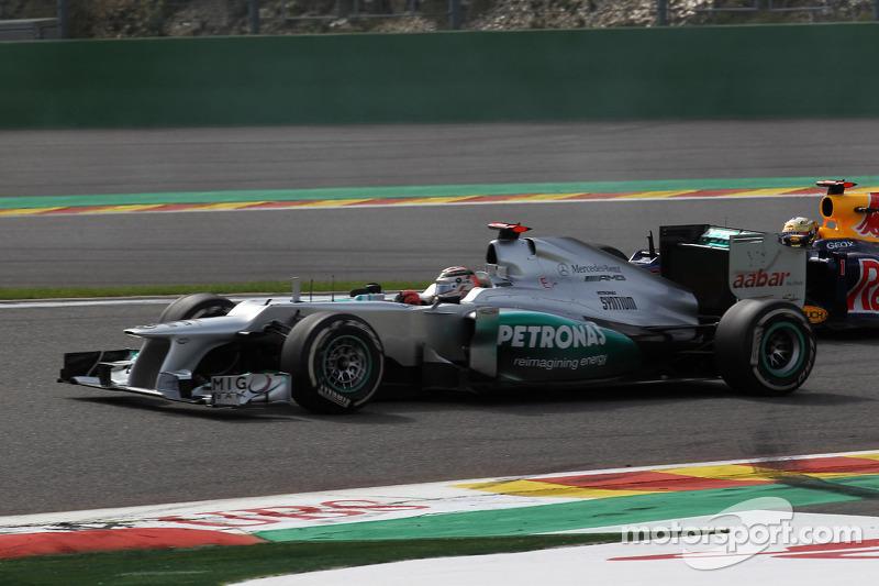 Michael Schumacher, Mercedes AMG Petronas y Sebastian Vettel, Red Bull Racing