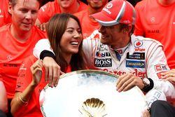 Race winner Jenson Button, McLaren celebrates with Jessica Michibata, and the team