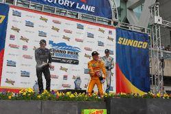 Race winner Ryan Hunter-Reay, second place Ryan Briscoe and third place Simon Pagenaud spray champag