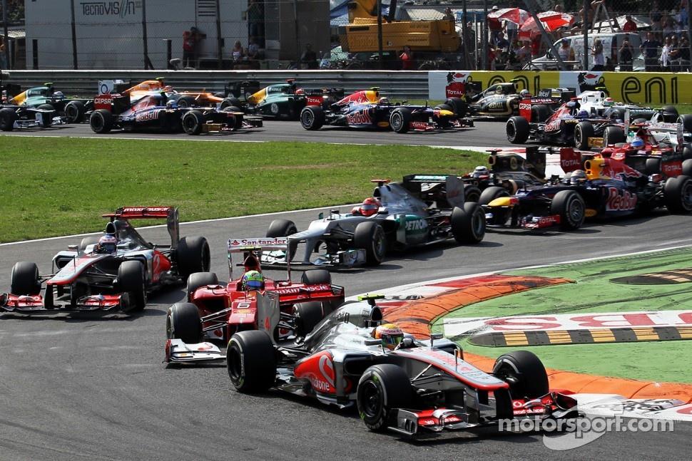 Lewis Hamilton, McLaren leads Felipe Massa, Ferrari at the start of the race